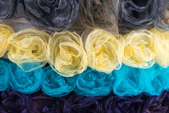 Background of different colors of cloth flowers Royalty Free Stock Images