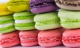 Background of different colors from a delicious dessert macaron, like a wall royalty free stock photography