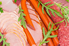 Background of different cooked meat products with greens Royalty Free Stock Image
