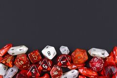 Background with different roleplaying RPG dice at bottom of dark black background with blank copy space