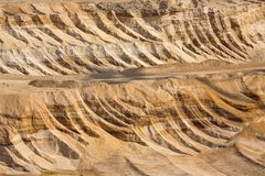 Background of digged soil in brown coal open pit mine. Germany stock photography