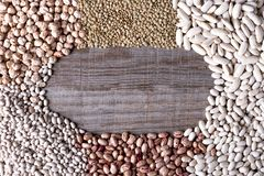 Background of distant legumes forming a circle on wooden board royalty free stock photography
