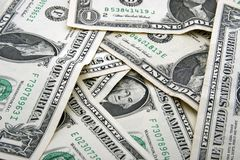Background of dollar bills. Background of scattered American one dollar bills or banknotes Royalty Free Stock Photography