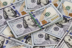 Background of dollar bills and a bundle of dollars on top Royalty Free Stock Photo
