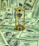 Time is money. Background with dollars and  clock. Concept photos : time is money Stock Images