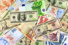 Background from dollars and euro bills. One hundred and fifty dollar banknotes on other currencies Royalty Free Stock Photo