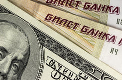 Background from dollars and rubles, close up Royalty Free Stock Image