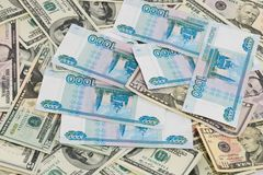 Background from dollars and Russian rubles Royalty Free Stock Images