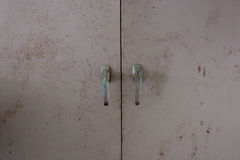 Background of door with lock in metal material and copyspace on wall. Stock Images