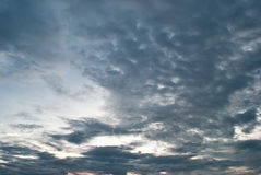 Background Dramatic dark sky with sun rays. Cloud before the sky is dark Stock Photo