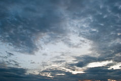 Background Dramatic dark sky with sun rays. Cloud before the sky is dark Stock Image