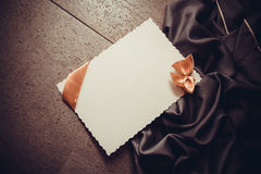Background with drapery and postcard Stock Photos