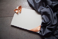 Background with drapery and postcard Royalty Free Stock Image