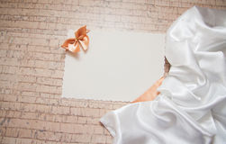 Background with drapery. White postcard with beige bow for text Royalty Free Stock Photography