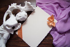 Background with drapery. White postcard with beige bow for text Stock Images