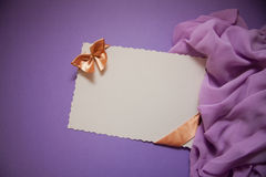 Background with drapery. White postcard with beige bow for text Stock Photo