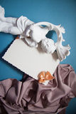 Background with drapery. White postcard with beige bow for text Royalty Free Stock Photos