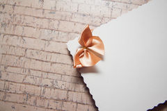 Background with drapery. White postcard with beige bow for text Stock Photos
