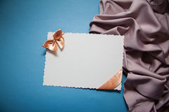 Background with drapery. White postcard with beige bow for text Royalty Free Stock Images