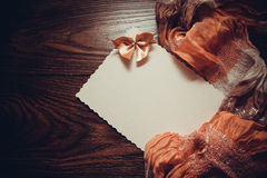 Background with drapery. White postcard with beige bow for text Royalty Free Stock Image