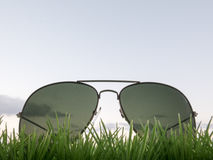 Background about dreams with sunglasses, grass and sky Stock Photo