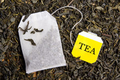 Background with dried black tea and tea bag Royalty Free Stock Images