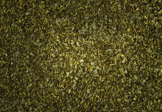 Background of dried chopped herbs Stock Images