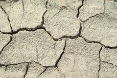 Crumbled cracked soil stock photos