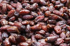Background of dried dates fruit, at the market. Background of dried dates t, at the open air market Royalty Free Stock Photography