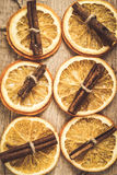 Background of dried orange and cinnamon sticks effect instagram Royalty Free Stock Photo