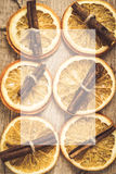 Background of dried orange and cinnamon sticks with honey for th Stock Photos