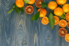 Background from dried oranges on a wooden floor. Royalty Free Stock Photos