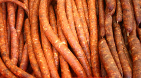Background with dried and smoked sausages Royalty Free Stock Photos
