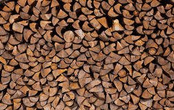 Background of dry chopped firewood logs. Stacked up on top of each other in a pile Royalty Free Stock Images