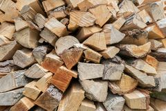 Background of dry chopped firewood logs in a pile. Background of dry chopped firewood logs in closeup in a pile royalty free stock photography