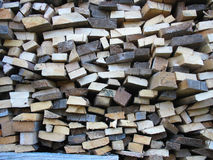 Background of dry chopped firewood logs in pile Stock Image