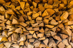 Background of dry chopped firewood. Logs in a pile Royalty Free Stock Images