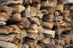 Background of dry chopped firewood logs in a pile Stock Photography