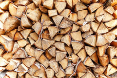 Stack of firewood. Background of dry chopped firewood logs in a pile Royalty Free Stock Photography