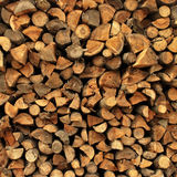 Background of dry chopped firewood logs stacked up Royalty Free Stock Photo