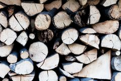 Background dry chopped firewood logs stacked up in a pile. Wood logs ready for fire winter chimney. Scenery from a. Background dry chopped firewood logs stacked royalty free stock photography