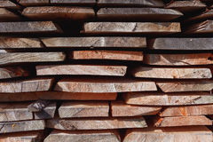 Background of dry chopped firewood logs stacked up on top of each other in a pile Stock Image