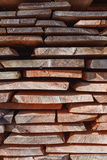 Background of dry chopped firewood logs stacked up on top of each other in a pile. Texture stock photos
