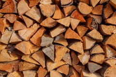 Background of dry chopped firewood logs stacked up on top of each other in a pile Royalty Free Stock Photo