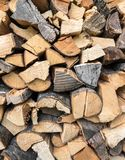 Dry firewood. Background of dry chopped firewood. Stock pyre dry for fuel. They use for cook and make heat when cold weather stock photos