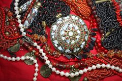 Background-east jewelry with magnificent coral necklace and pearls Royalty Free Stock Image