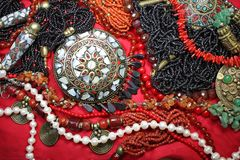 Background-east jewelry with magnificent coral necklace and pearls Stock Image