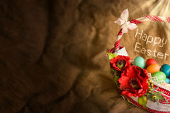 Background with easter basket. Burlap background with easter basket, colourful eggs and empty space for your text Stock Photos