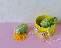 Background for Easter. Easter background with blue and green eggs and yellow flowers stock photos