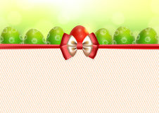 Background with Easter eggs and bow. Festive background and six green patterned Easter eggs and one red Easter egg with bow and place for text Stock Image